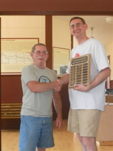 Bruce Reason (left), CRF President, congratulates Paul Krueger